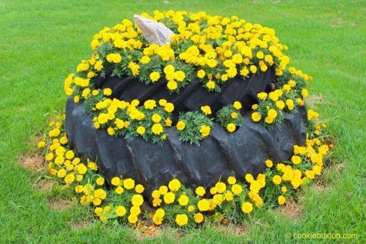 Flores en neumáticos reciclaje